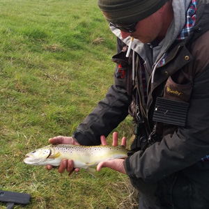 First effort on the dry fly for Darren was rewarded with a nice brown trout. Well done